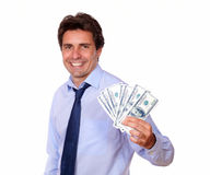 Attractive business man holding up cash money Royalty Free Stock Images