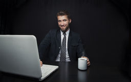 Attractive business man with a notebook and a cup of coffee Royalty Free Stock Photo
