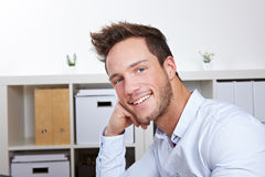 Attractive business man in office Royalty Free Stock Photos