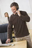 Attractive business man on phone. Royalty Free Stock Photos