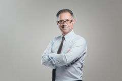 Attractive business man portrait on gray background Stock Photos