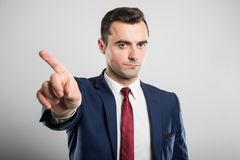 Attractive business man showing denial gesture royalty free stock image