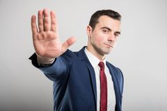 Attractive business man showing stop gesture royalty free stock photography