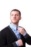 Attractive business man straightens his tie Stock Photo