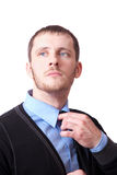 Attractive business man straightens his tie Stock Image