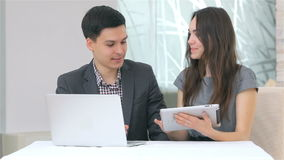 Attractive business man and woman discussing stock footage