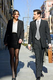 Attractive business people walking on the street. Couple working Stock Photography