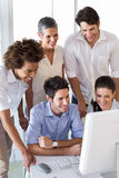 Attractive business people working hard on computer Stock Photo
