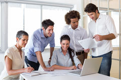 Attractive business people working in the office Stock Image