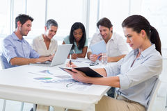 Attractive business people working in the office Royalty Free Stock Photos