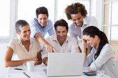 Attractive business people working in the office Stock Photography