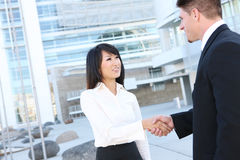 Attractive Business Team Handshake Stock Photos