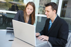 Attractive Business Team on Laptop Stock Photo