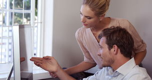 Attractive business team working together. At home in slow motion stock footage