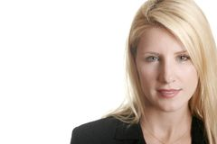 Attractive Business Woman. A headshot of an attractive blonde in a suit, with a friendly but serious look on her face.  Ample white space to left for text Stock Photos