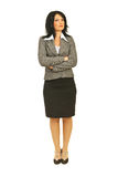 Attractive business woman with attitude. Full body of serious attractive business woman with attitude standing straight with arms folded on white background royalty free stock photos