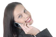 Business woman with cellphone, listening, talking, facing camera, wide smile, white background Royalty Free Stock Images