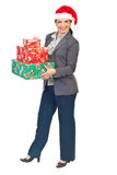 Attractive business woman with Christmas gifts royalty free stock photo