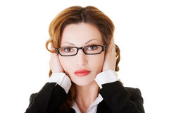 Attractive business woman with covered ears. Stock Image