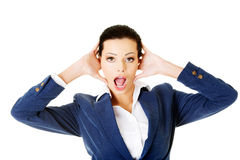 Attractive business woman covers her ears. Stock Image