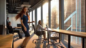 Attractive business woman dancing inside of modern office stock video