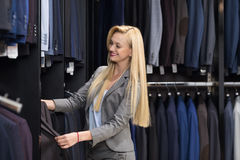 Attractive Business Woman Fashion Shop, Customer Choosing Clothes In Retail Store, Young Girl Shopping. Attractive Woman Fashion Suit Shop, Customer Choosing Stock Photo