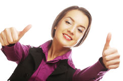 Attractive business woman giving thumbs up Royalty Free Stock Photos