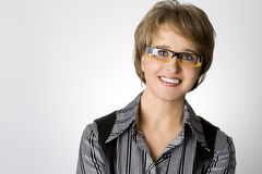 The attractive business woman in glasses. On gray royalty free stock image