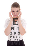 Attractive business woman in glasses and eye test chart isolated Stock Photos