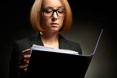 Attractive  business woman with glasses and folder Royalty Free Stock Photography