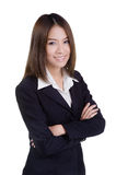 Attractive business woman with her arms crossed suit isolated Stock Photos