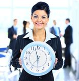 Attractive business woman holding clock Royalty Free Stock Photography