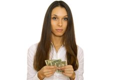 Attractive business woman holding dollars Royalty Free Stock Images