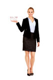 Attractive business woman holding small shopping basket Stock Photo