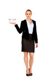 Attractive business woman holding small shopping basket Stock Photography