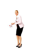 Attractive business woman holding small trolley Royalty Free Stock Photos