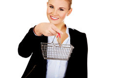 Attractive business woman holding small trolley Royalty Free Stock Photography