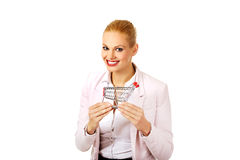 Attractive business woman holding small trolley Royalty Free Stock Images