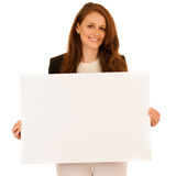 Attractive business woman holding white banner with copy spave f Royalty Free Stock Photography