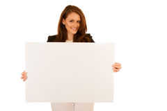 Attractive business woman holding white banner with copy spave f Royalty Free Stock Images