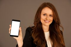 Attractive business woman holds a tablet or smartphone wtih blan royalty free stock photos