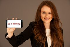 attractive business woman holds a smartphone e-banking Royalty Free Stock Photo