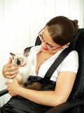 Attractive business woman  with kitty. Attractive business woman playing with kitty Royalty Free Stock Images