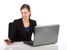 Attractive business woman looking on her smartphone Stock Photo
