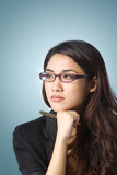 Attractive business woman looking sideways Royalty Free Stock Photography