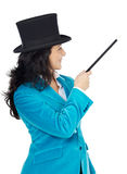 Attractive business woman with a magic wand and hat Stock Photo