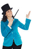 Attractive business woman with a magic wand and hat Royalty Free Stock Images