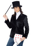 Attractive business woman with a magic wand and hat Royalty Free Stock Image