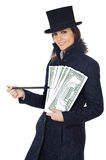 Attractive business woman with a magic wand and hat making appea Royalty Free Stock Image