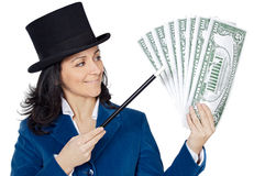 Attractive business woman with a magic wand and hat making appea Royalty Free Stock Photography
